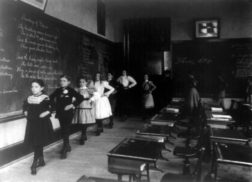 "liquidnight:  Frances Benjamin Johnston - ""Fancy step"" around the classroom, 3rd Division, circa 1899 [via trialsanderrors]"