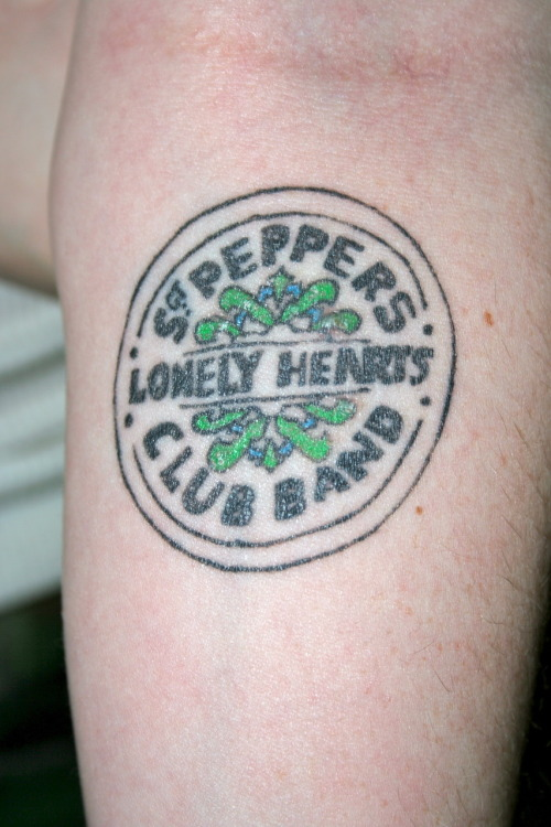 hotroller:  fuckyeahthebeatles:  Beatles tattoo number 2. The Sgt. Pepper logo, colors are a bit more simplified (read pale skin…certain colors won't pop very well).  Done in November, left forearm.  love it.  I'm planning to add more…  If I would ever get a tattoo, this would be it.