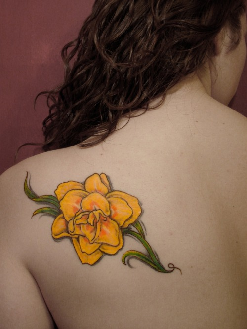 a double daffodil in celebration of my mom's 5 years in remission from breast cancer. done by tattoo tony, express yourself, new paltz, ny