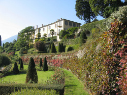 Villa Serbelloni has a very ancient story, property of the Sfondrati family in 1533, became property of Count Alessandro Serbelloni who gave to the estate his body and his soul. The external aspect, ample but simple wasn't modified, but the inside was carefully decorated, from the vaulted ceiling, to the paintings and other art's objects. The Duke Serbelloni, anyway, was more into the garden than the villa, he spent incredible amounts of money, made built tracks practicable for wheeled traffic, avenues and paths, for an extension of 18 km. The Duke died in Bellagio in 1826, the villa passed to his sons, Giovanni Battista and Ferdinando, and it started to decay progressively after their death; but since 1870 their heirs leased it out to Antonio Mella  who made it a depandance of the Grande Bretagne Hotel; in 1907 they sold it to a swiss society that made it the Serbelloni Hotel. The Hotel was bought by the Princess Ella Walker and finally left as bequeath to the Rockefeller foundation in 1959. Today the villa is used as place for meetings and stay. The villa gave hospitality to several famous people, when it was propriety of Sfonderati : the Emperor Massimiliano I, Leonardo da Vinci, Lodovico il Moro, Bianca Sforza, the Cardinal Borromeo. During the XIX century: Pellico, Moroncelli, the Emperor Francesco, the Queen Victoria, the Kaiser William, Umberto I, writers as Manzoni, Grossi and Pindemonte. photo by: steinbock.bonnie