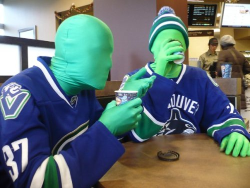 The Green Men of GM Place. Mocking the visiting team penalty box since '09.