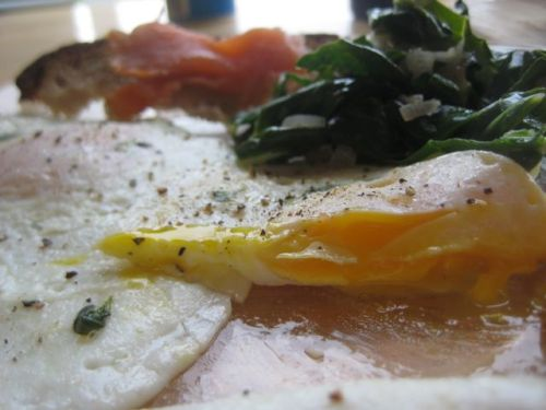 kristendish:  Eggs over easy with garlic greens and smoked salmon