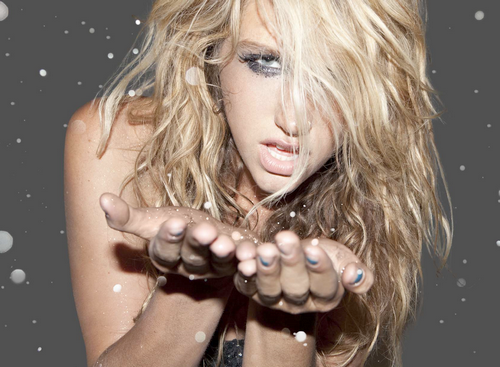 "If you go to a Ke$ha concert, you WILL be blasted with glitter. From a new interview she did with Entertainment Weekly: "" ""If I smear glitter on my face, you don't have a choice—you will be more attracted to me. It's part of our brand makeup. So anyway, then I started thinking, why just do my eyes? Why not my entire body? And at the end of my shows why don't I put a backpack on that's like a hand-held cannon and blast glitter at people? So not only do I look attractive, but so does everybody who's dancing? It's kind of like become my thing."" This bitch is crazy. And I like it. Yes, it's all probably very fabricated, in a look-at-me-I'm-so-edgy-and-unpredictable Megan Fox sort of way, but hey, I've always liked Megan Fox. Another tidbit: ""On people thinking that she runs around with the likes of Paris Hilton and Nicole Richie:""Oh, gross! I'm from the opposite of that. Do you think that those girls dig through the garbage for their clothes? That's what I'm saying. And, you know, would they live in a house with 10 people that they've never met, you know? And would they be OK if they never came home for four days and just went to Vegas on a whim? Like, would they never wear high heels when they go out so they can run from the cops? Very different."" For More: Check out music-mix.ew.com/2010/01/21/kesha-quotes/"