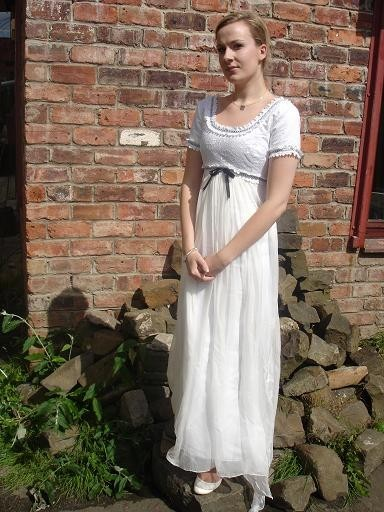 "1980's Regency style dress with lace and ribbon detail. Chiffon over lay has small train.Bust: 33""   Waist: 27.5""    hips: 34""    $391 This can be found on ETSY.com at : Dragonfly Dress Desgn I love this too. I'm a sucker for simple. I don't really like billowing dresses."