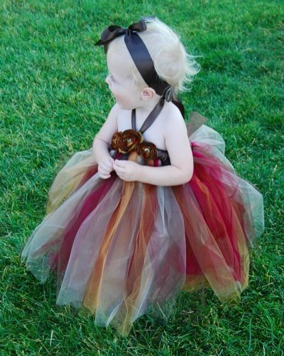 This is sooooo cute. I just love it! For a flower girl dress or just a dress for fun this is toooo cute. Found at Etsy.com in the Fairy Wonderful shop.