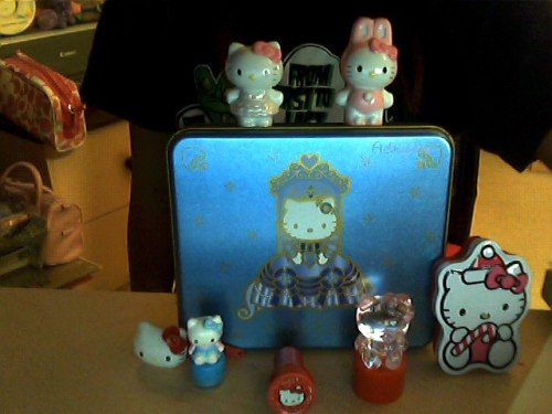 HK box, stamps, hair clip and glass figurines.  Submitted by littlegrainofrice