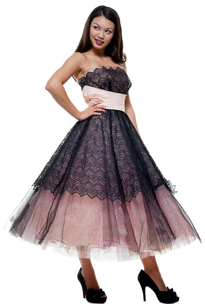 This is a party dress, but with me and my like for the non-traditional I would like this even as a wedding dress, it's just so cute and it's vintage to boot. More on this dress at : Click Here