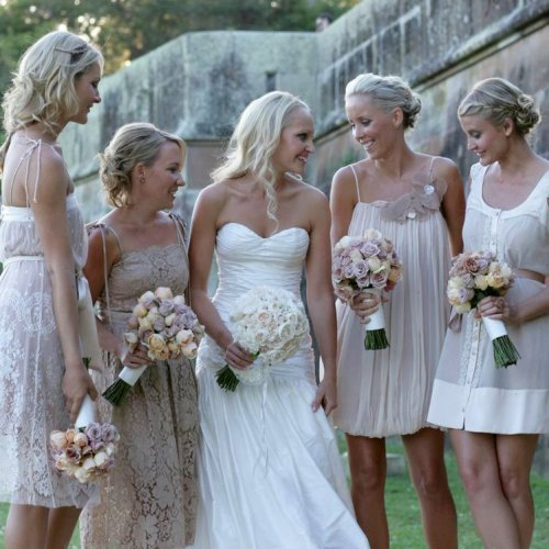 I love this idea of have your bridesmaids dresses being mismatched in design yet keeping with the color theme. I had always thought that was just sooo unique and WALA! It appears to be a trade for 2010.