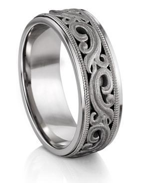 This ring here is one of many of love at http://www.titanium-jewelry.com/. Though this website caters to rings for men there are some for women and even some that are uni-sex. This website to me is has some very unique rings. And for the men who work on cars, building houses, and working lets say on the roads there is a collection of no scratch rings. At far as a wedding goes this… the rings I mean, is the only thing I believe in splurging for because they are the one thing you will have till you die or split… hopefully death comes first. But you don't want to spend a little and then have to get it fixed. You want it to last as long as your love does. I would spend more on the ring for my future husband then I would on my dress.