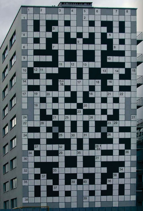 robot-heart:   Though a crossword puzzle with 19 squares across and 34 squares high might seem daunting enough, perhaps it might appear more challenging if the physical puzzle stands over 100 feet (30 m) tall. Located on the side of an apartment complex in Lviv, Ukraine, the world's largest crossword puzzle — in physical size, at least — is an interactive art work aimed at bolstering critical thinking and urban exploration. Similar to a scavenger hunt, the clues to the crossword puzzle are scattered throughout the city's major landmarks. Visitors must explore popular attractions, such as historic monuments, museums or parks, before they're able to solve the building's brainteaser. (via Giant Crossword of Lviv | , Ukraine | Atlas Obscura)