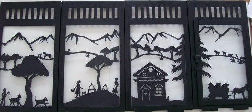 Beautiful papercut panels for a lantern.