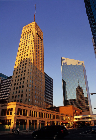 "Above is the W Minneapolis - The Foshay, better known as simply the Foshay Tower. It was completed in 1929, just a few months before the stock market crash. The building was modeled after the Washington Monument and is credited with being 'the first skyscraper west of the Mississippi'. It remains to this day one of the tallest concrete skyscrapers in the world, second only to the Empire State Building. The building was named after Wilbur Foshay, a utility company magnate who intended for the tower to become headquarters for his empire and his personal residence. The dedication of the building was quite grand, with 25,000 guests - each receiving a gold pocket watch. It even included a march written by John Philip Sousa, the ""Foshay Tower-Washington Memorial March"", which was played only once during Foshay's lifetime because the $20,000 check Foshay wrote to him bounced. Sousa then forbade anyone to play the March until the debt was repaid, which was finally done in 1988. Info by wiki & lileks Photo by Ron Layters"