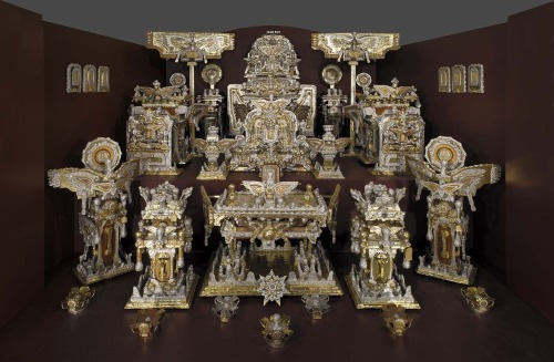 The Throne of the Third Heaven of the Nations' Millennium General Assembly  ca. 1950-1964  James Hampton Born: Elloree, South Carolina 1909 Died: Washington, District of Columbia  1964  gold and silver aluminum foil, Kraft paper, and plastic over wood furniture, paperboard, and glass 180 pieces  Smithsonian American Art Museum