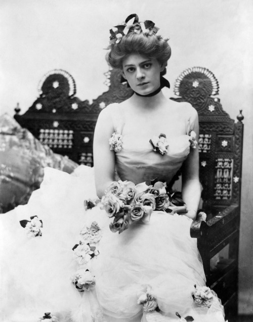 "Ethel Barrymore as Madame Trentoni in ""Captain Jinks of the Horse Marines"". Photo is from 1901. I'd say something about how much I like this photo, but I think I'd ruin it then, since words do not bring this photo much justice - is it the roses, the multi layers of the dress, the ribbon around the neck, the elegant hairdo, the ribbons…? Image Source: Dr. Macro's"