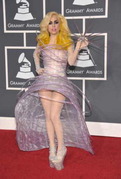 Lady Gaga in Armani Prive at last night's Grammy awards. Love the weird orb she's holding. What is that and who designed it?