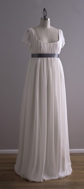 Jane - Organic Cotton and Chiffon Eco Wedding Dress I love this dress, it is very simple. It reminds me of somthing Elizabeth Bennet would wear in Pride & Prejudice. I found it in an Etsy.com shop. It's gonna run you 1,200$ Description Jane was inspired by the beautiful regency era ball gowns.Jane features an empire waist and a low scoop neckline. The empire waist is accented with a ribbon sash, shown here in dark grey. The sheer silk chiffon overlay is gathered onto the fitted organic cotton underlayer of the bodice. A low scoop back mirrors the front. The skirt is full and free with all three layers slightly gathered at the waist and hemmed for a soft bubble hem effect.Jane is pictured in organic cotton with an unbleached silk chiffon overlay. Fully lined in organic cotton. Each dress is made by hand when ordered. Please allow up to 12 weeks for delivery. Depending on the season, rush orders may be available. Contact me with your wedding date for more information.
