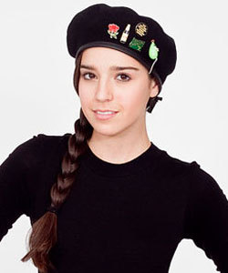 "Unisex wool military beret with badges, $40.00 at American Apparel.  I am so excited that American Apparel is now issuing merit badges for hipsterdom.  Based on this blurry image, it appears this girl has received: the living in Portland, Oregon badge; the drinking imported beer badge; the being ""so over Animal Collective"" badge; the vegan badge; and the ""I was featured in a group show in Echo Park"" badge."