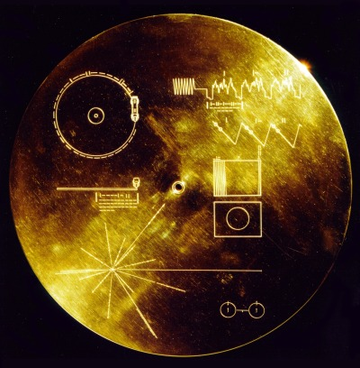 "Voyager Golden Record  The Voyager Golden Record are phonograph records which were included aboard both Voyager spacecraft, which were launched in 1977. They contain sounds and images selected to portray the diversity of life and culture on Earth, and are intended for any intelligent extraterrestrial life form, or far future humans, who may find them. The Voyager spacecraft are not heading towards any particular star, but Voyager 1 will be within 1.6 light years of the star AC+79 3888 in the Ophiuchus constellation in about 40,000 years. This gold aluminum cover was designed to protect the Voyager 1 and 2 ""Sounds of Earth"" gold-plated records from micrometeorite bombardment, but also serves a double purpose in providing the finder a key to playing the record. The explanatory diagram appears on both the inner and outer surfaces of the cover, as the outer diagram will be eroded in time. Flying aboard Voyagers 1 and 2 are identical ""golden"" records, carrying the story of Earth far into deep space. The 12 inch gold-plated copper discs contain greetings in 60 languages, samples of music from different cultures and eras, and natural and man-made sounds from Earth. They also contain electronic information that an advanced technological civilization could convert into diagrams and photographs. Currently, both Voyager probes are sailing adrift in the black sea of interplanetary space, having left our solar system years ago."