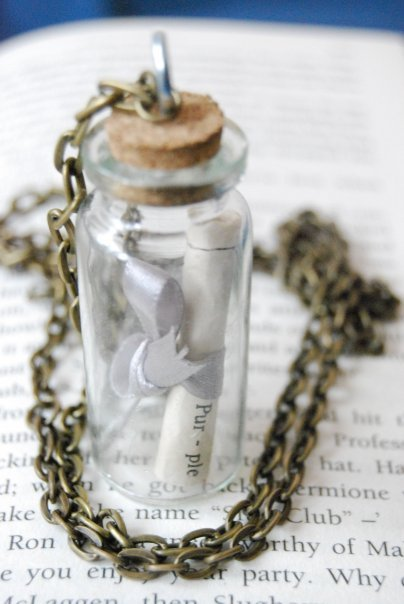 fuckyeahbookshelves:  Me and my friends are making these necklaces and they are the awesomest friends in the WORLD!!! What do you think of them?