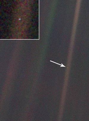 "The ""pale blue dot"" picture is 20 years-old. Taken in 1990 by NASA's Voyager 1 spacecraft, the ""pale blue dot"" photo shows what our planet looks like from four billion miles away. Earth is the tiny speck of light indicated by the arrow, and enlarged in the upper left-hand corner. The pale streak over Earth is an artifact of sunlight scattering in the camera's optics. via npr.org"