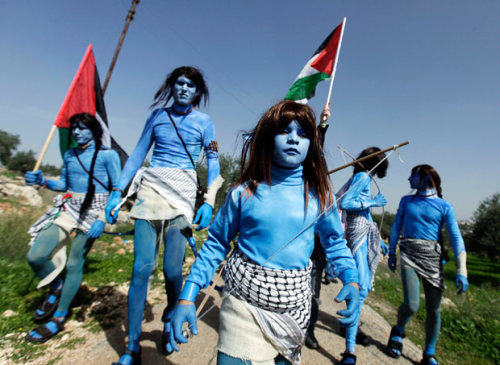 Photo of Palestinians dressed up as Navi tribe from the film Avatar during weekly protest against the wall