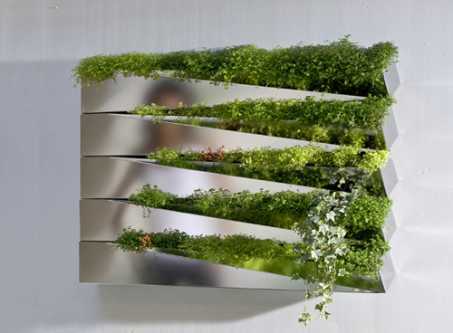 "verticaltheory:  Grass Mirror by h2o Architects ""Antique philosophers often turned to nature for contemplation. Nature was used as a mirror. The Grass Mirror project revisits, in a way, this idea of contemplation. But to convey a contemporary image requires further complexity. Nature overflows, it is multiplied by the different reflections. One's own image is fragmented. Frontiers between nature and culture are blurred. It is the twist (geometric deformation) of the rectangle which reveals this nature. The plants sit in the hollow of the deformation. This basic figure can be repeated indefinitely, from object to surface and surface to object. The whole is a little more than a multiple of its parts…"" –Miguel Mazeri, anthropologist via design-milk.com"