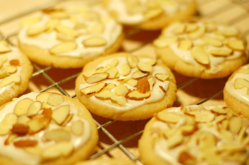 Delicious entirely almond shortbread cookies that I made for my friend, Wendy, who is currently living in Maine. These are my favorite cookies, I think they will soon be hers too. Want to make these cookies? Here's the recipe: Ingredients 1 cup butter, softened¾ cup white sugar1 teaspoon almond extract2 cups all-purpose flour⅛ teaspoon salt1 cup sliced almondsIcing Ingredients 2 cups confectioner's sugar1 tablespoon butter, softened1½ teaspoons almond extract2½ tablespoons half-and-halfPreparation  1. In a large bowl, cream together the butter, sugar, and almond extract until smooth. Combine the flour and salt; stir into the butter mixture until well blended. Cover and refrigerate for 3 to 4 hours or overnight. 2. Preheat the oven to 300ºF (150ºC). Roll dough into teaspoon sized balls and place on an ungreased cookie sheet. Using your index finger, flatten out dough balls by lightly pressing down on them from the center, outward, in a circular motion. 3. Bake for 30 minutes in the preheated oven, or until firm. Remove cookies from cookie sheets to cool on wire racks. 4. Once cooled, apply a thin layer of icing to each cookie and add chopped almonds on top.