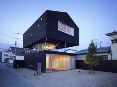 Astounding architecture for this Japanese house.  'this house, located in Hiroshima, Japan, designed by naf architect &  design is developed on 3 levels. The first level is a black cedar  box containing the bedroom and the entrance, the second level a terrace  whit nothing but steel columns holding up the third level which contains  the living room and kitchen.'