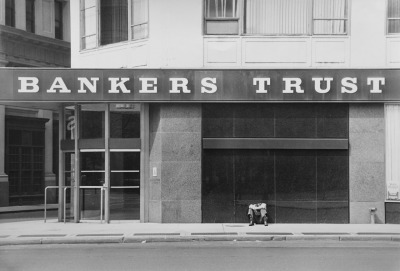 'A Man Sleeps outside Bankers Trust Building, New York. 23/4/1973.' Clive Limpkin is a press photographer with an impressive portfolio from the late sixties onwards.