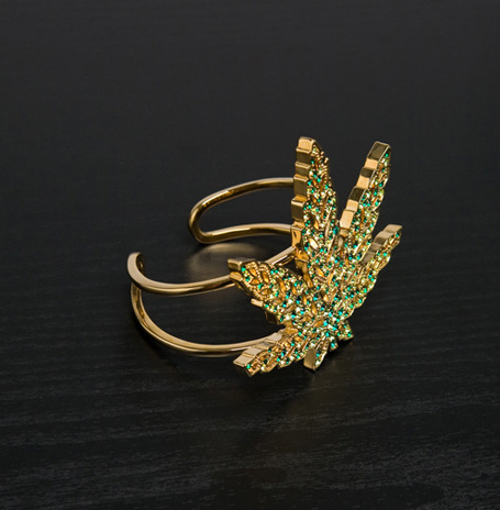 Marijuana leaf bracelet by Disaya, on sale for $197.00 at ForwardForward. Look at me!  I am so edgy that I am wearing a bracelet with marijuana on it.  Did you know I smoke pot too.  I am not like those uptight pricks.  I am edgy and individual, just like over 40 percent of Americans.  Pay attention to me, I am counterculture!  Only Lucien Pellat-Finet can get away with this shit, and it is still attention whorish.