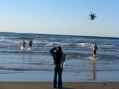 A flying parachute-fan guy buzzed my friends while they were in the ocean!