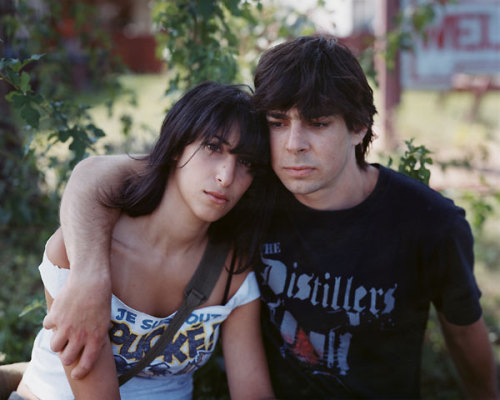 """Martha and Anthony 2004"" from Alec Soth's Niagara  Each time I've turned the last page of Alec Soth's Niagara I've been left feeling what I can best describe as contemplative. It sounds terribly cliché but that book makes me think about life – my life and life in general – and being human. I never see Niagara as being gloomy but that may be entirely despite the sequencing of its photos. You'll see a couple of photos of motels, motel exteriors, motel interiors, scenes from Niagara, a portrait or two – quite possibly of a couple – and then Soth hits you with the falls.  We could go on a veritable metaphor safari with the photos of Niagara Falls. The river flows to the falls, unstoppably. It all falls down in the end. And I guess that's how life is; we live it and then we die. Me being accepting of that may be why I don't see Niagara as a gloomy work. It's certainly tinged by melancholy but, for me, that's about as far as it goes down that path.  What lies behind the pictures is more intense, as Soth describes in this interview with Roger Richards in The Digital Journalist:     ""Before ever having been there I liked the place. I wanted to explore the scenes of   love, and approach it with a kind of lyrical sensibility,"" says Soth.      But what Soth found was much more than he had bargained for. ""After the fifth trip, I   was done,"" he relates. ""The Mississippi work was fun. But here I was having negative   experiences. After the fifth trip it was hard to go back.""      Soth says that as the work progressed it became like a downward spiral, and became   darker and darker in tone.      ""There's this one guy named David. He may not be in the book … his girl committed   suicide. He had this collection of love letters … the letters were so raw."" Soth said the   work was becoming too dark. He had wanted to maintain the sense of melancholy   without it becoming so intense. But it was becoming harder to do.   The melancholy may never become too intense in Niagara but it is nonetheless an intense work. The sequencing of the photos, the manufactured romance of the motels and, perhaps most of all, the people in the portraits, again coupled with the landscapes of the falls. It all brings out feelings of emptiness, loss and futility. But I also find a hope of redemption in Niagara. Probably because of Soth's portraits, which are never less than sympathetic. They show people I don't imagine having much in common with, but in a way which makes me stop and look again. To transcend first impressions or even knee-jerk prejudices.  I picked the photo above because to me it illustrates as well as any one photo could what I write in this post. But I hope I also managed to illustrate thoroughly that Niagara isn't a book of portraits anymore than it is a book of landscapes. If you haven't done so already, please visit Niagara on Alec Soth's website and look through the photos. It's worth noting that although the selection of photos there is excellent the sequencing is not the same as in the book. Some photos from the book are also missing and some photos on the site are not in the book."