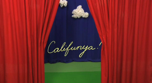 "Califunya: Episode 4 - The Key to My Happiness Is it me or is Califunya — Becky Stark's cooky new 'thing' — starting to gain some sort of dark, Lynchian significance? In this episode Becky finds a key to her happiness in the trash(!) but quickly forgets what it is or what it does and ultimately rejoices in the fact that it is big and beautiful. It opens nothing she states before knowingly looking at the viewer. Do we ourselves tend to pride in that which is without function yet superficially desirable? Does our potential happiness diminish the more we adhere to such a paradigm? In the following episode she ushers in Colin Meloy who, carrying a heavy suitcase filled with ""Despair"", sings 'The Kingdom of Spain', a sad song about golden ages long lost. I could also write paragraphs about how Episode 1 is allegory for the biblical apocalypse & how Episode 2, entitled 'Bluebird', might as well be called 'Blue Velvet', but you can't deny that something is going on here."