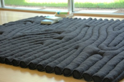 milk tooth's rain: redeploy rug repurposed Russian army blankets as a rug as Rebekah Rauser