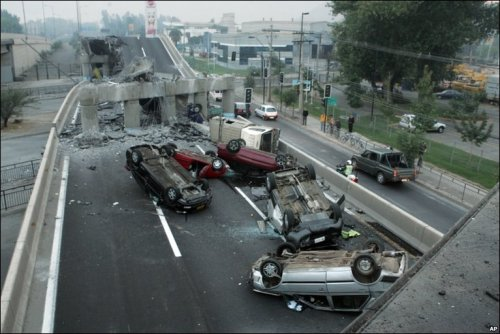 Cars overturned in Chile. An AP photo by David Lillo, as seen on the BBC News front page and In Pictures. (Their coverage.)