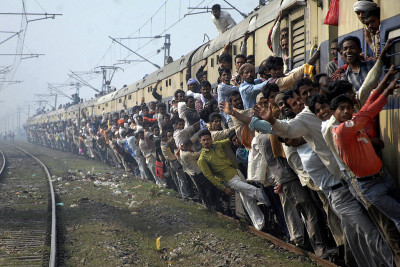 proust73:  ALL ABOARD! Passengers traveled on an overcrowded train in Patna, India. (The Wall Street Journal - Krishna Murari Kishan/Reuters)