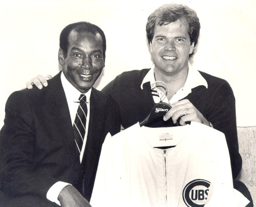 1981; Chet Coppock and Ernie Banks pose together at Wrigley Field. Earlier that day, the Cubs placed Ernie's No. 14 on a banner above the left field foul pole.