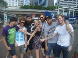 Jess and Josh meeting Four Year Strong in Sydney and showing off the Team Up! tattoos!