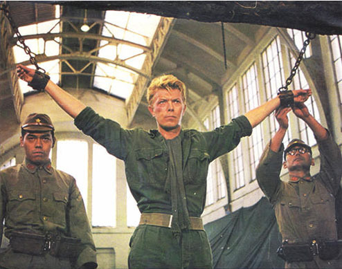 noonereallywins:  bohemea:  Even in chains Bowie looks authoritative. He & Russell Crowe have that in common. bowielovesbeyonce:rup3t   This is like twelve of my sexual fantasies in one.