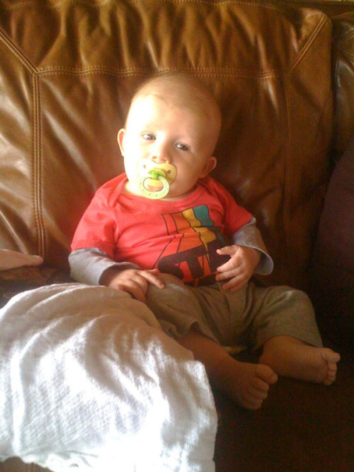 My little couch potato! He loves to sit with mom and dad and watch TV!!