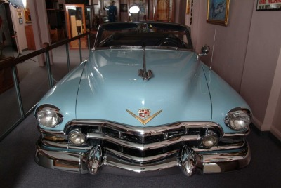 scabboy:  The 1952 Cadillac that Hank Williams passed away in. Charles Carr drove the Cadillac to the emergency room entrance where two orderlies picked Hank up by the armpits and feet and carried him into Oak Hill Hospital Emergency Room. Hank was pronounced death at 7:00am January 1, 1953 by Dr. Diego Nunnari. The doctor concluded Hank had probably died some six hours earlier, but he could not determine the time of death with any certainty. Hanks body was then taken across the street to the Tyree Funeral Home where an autopsy was performed. Dr. Iven Malinin who performed the autopsy was a Russian intern who spoke almost no English. His report noted needle marks in Williams' arms, bruises on various parts of the body, a welt on his forehead and hemorrhages in the heart and neck. The official cause of death was attributed to acute right ventricular dialation, an unusual conclusion, meaning that his heart just stopped beating. Traces of alcohol but no drugs were found in his blood, probably because he was asked not to look for them.