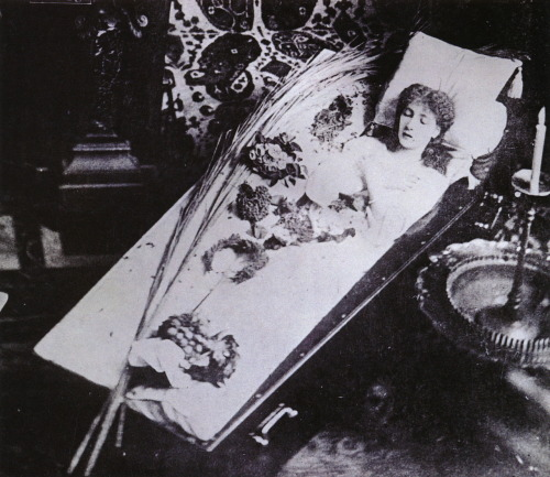 "bloodmilk:  sabiavida:  liquidnight:  The Great Sarah Bernhardt Asleep in Her Coffin, Silver gelatin print, circa 1882 This iconoclastic Frenchwoman was arguably the most famous actress of the 19th century. She went on to become a film star in the early 20th century. In the 1880s, Bernhardt (1844-1923) made her own funeral arrangements. She picked out her own coffin because she was going to ""sleep"" in it forever. She had it delivered to her home and regularly slept in it. In her 1907 autobiography she wrote, ""My bedroom was very tiny. The big bamboo bed took up all the room. In front of the window was my coffin, where I frequently installed myself to learn my lines."" Bernhardt has this photograph taken in the classic postmortem style of the early 1880s. Though she was 78 years old when she died, this photograph depicts her in a death pose while she was still young and beautiful. Thus, this ersatz postmortem photo is the image many associate with her death. From Sleeping Beauty II - Grief, Bereavement and the Family in Memorial Photography by Stanley B. Burns, M.D."