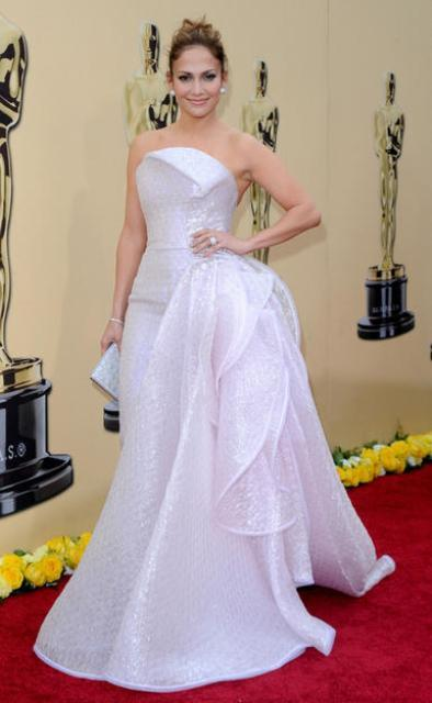 "Jennifer Lopez - 82nd Annual Academy Awards ""She put the emphASSis on the wrong syLLAble. Am just sayin'…"" Yes, I totally get it. JLO loves to show off all her assets, but this here planetary orbital mess looks like some elaborately designed piece of bubble wrap. I mean, doncha just wanna reach out and pop them bubbles. I dunno what she had in mind when she decided to wear this Armani Privé gown. And that bunched material on her side, let's call it her hip adornment, just weighs her down. If we can just take that piece off and pop some bubbles, we'd be set!"