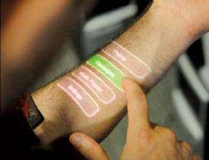 "Body  acoustics can turn your arm into a touchscreen -  New Scientist Called Skinput, the system is a marriage of two technologies: the ability to detect the ultralow-frequency sound produced by tapping the skin with a finger, and the microchip-sized ""pico"" projectors now found in some cellphones."