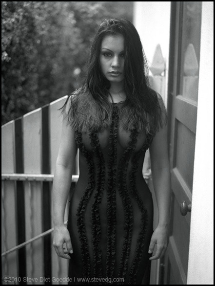 Aria Giovanni, Pasadena 2002A previously unpublished photo of Aria Giovanni shot in the rain at a friend's house in Pasadena in 2002. It was cold and wet that January day, but Aria was a real trooper, and we both managed not to get sick (or get my camera wet). www.stevedietgoedde.com