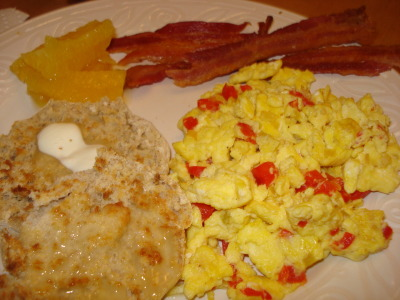"vacation breakfast: scrambled eggs with sauteed onions, red peppers and hot peppers, english muffin with butter, fresh florida orange segments (picked from a neighbor's orange tree) and low-sodium BACON* mom and i made ourselves breakfast one morning because she had a bunch of bacon she wanted to use up while she had company.  *although the bacon was ""low sodium"" it still tasted like regular bacon.  the only difference was, we weren't parched and chugging water for the rest of the day.  low-sodium bacon FTW!  ^also related to bacon - i showed my mom how to cook bacon in the oven on the broiler pan so that 1. the bacon comes out flat, evenly cooked and crispy, and 2. the bottom part of the broiler pan catches the bacon fat to save for future use (or easy disposal - but that is blasphemy!)"