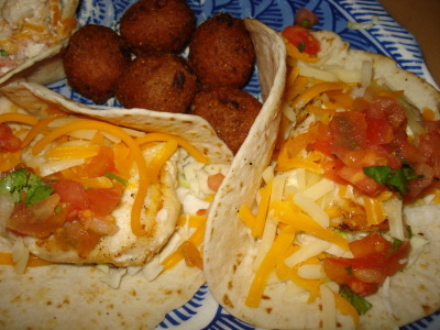 florida black grouper fish tacos with hush puppies from the fish house on fort myers beach you can get the fish grilled, broiled, blackened or fried… i went with grilled because i LOVE me some fresh grouper and IMO it's the perfect way to cook that particular fish. also, hush puppies used to be my favorite when i was a kid.