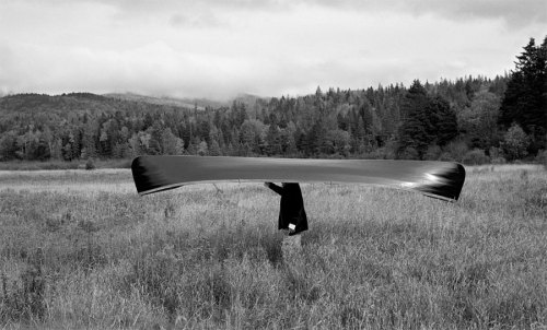 Man with Canoe on Head, by Rodney Smith.