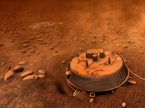 Huygens on Titan In 2005 the robotic Huygens probe landed on Titan, Saturn's enigmatic moon, and sent back the first ever images from beneath Titan's thick cloud layers. This artist's impression is based on those images. In the foreground, sits the car-sized lander that sent back images for more than 90 minutes before running out of battery power. The parachute that slowed Huygen's re-entry is seen in the background, still attached to the lander. Smooth stones, possibly containing water-ice, are strewn about the landscape. Analyses of Huygen's images and data show that Titan's surface today has intriguing similarities to the surface of the early Earth. Image Credit: ESA  via www.nasa.gov