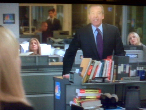 …and if you look closely, Brian Williams is running behind New York 1 business anchor Annika Pergament's desk. Heh.